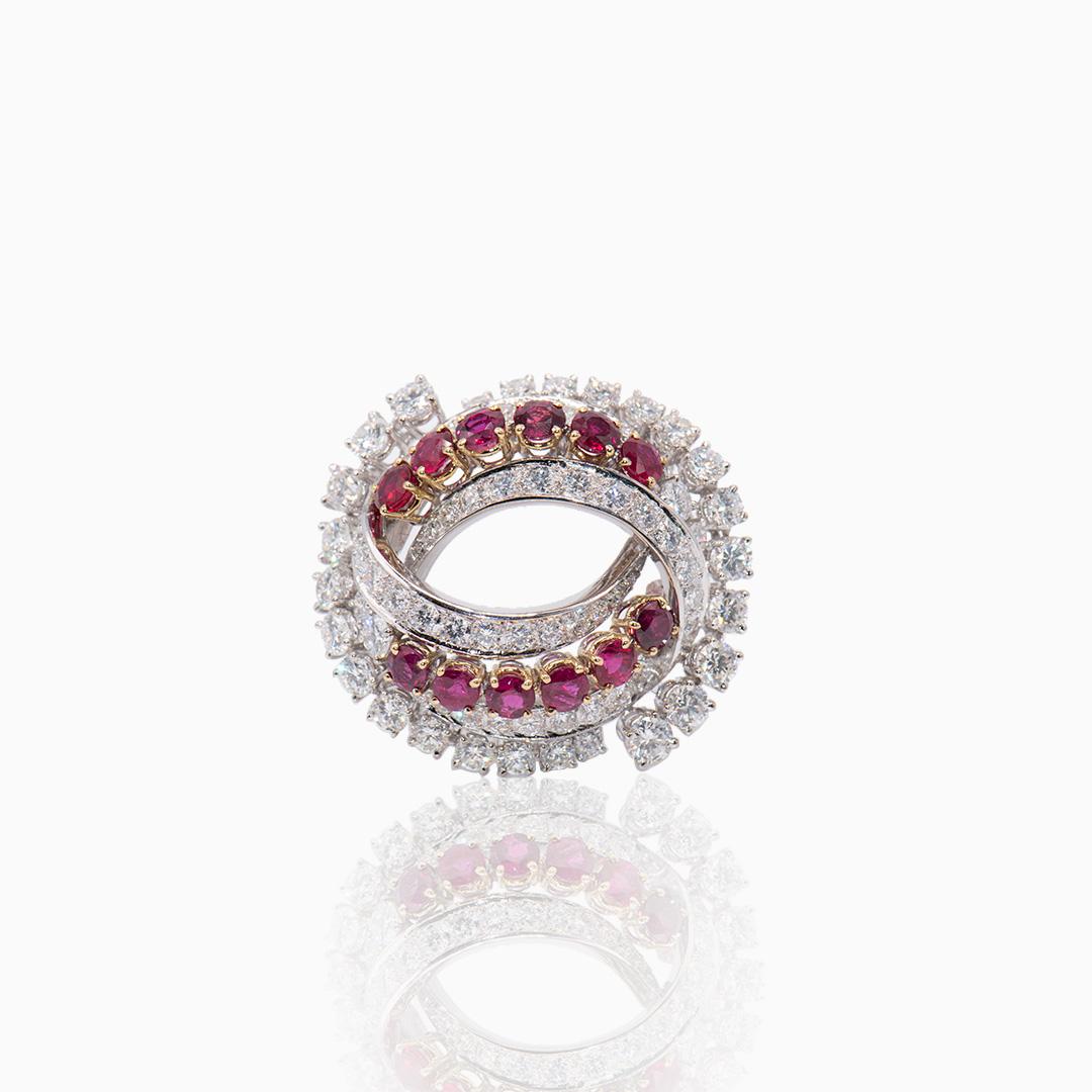 Broche Oro Blanco Diamantes y Rubíes en Espiral