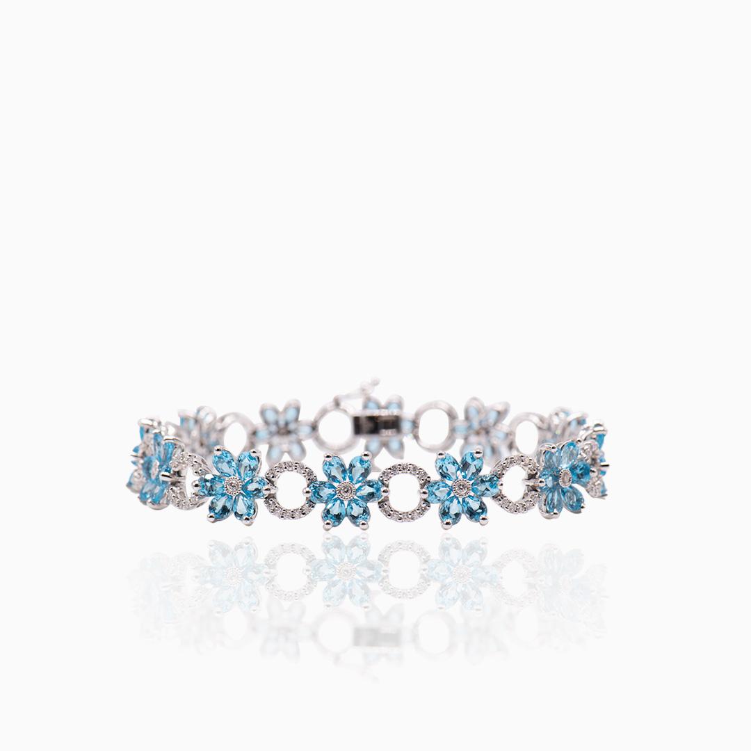 Pulsera Oro Blanco Topacios y Diamantes Floral