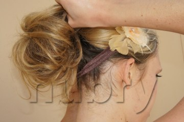 If you prefer a lower bun, you can pull down on the pieces of hair in the bun