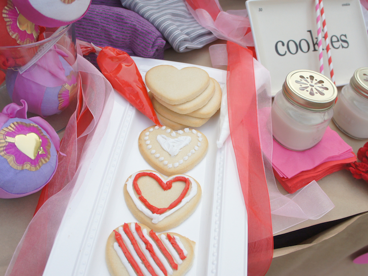 Decorate heart cutout cookie for vday