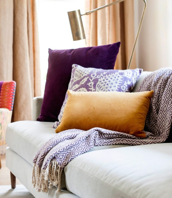 stacked pillows on a couch are great to layer a room