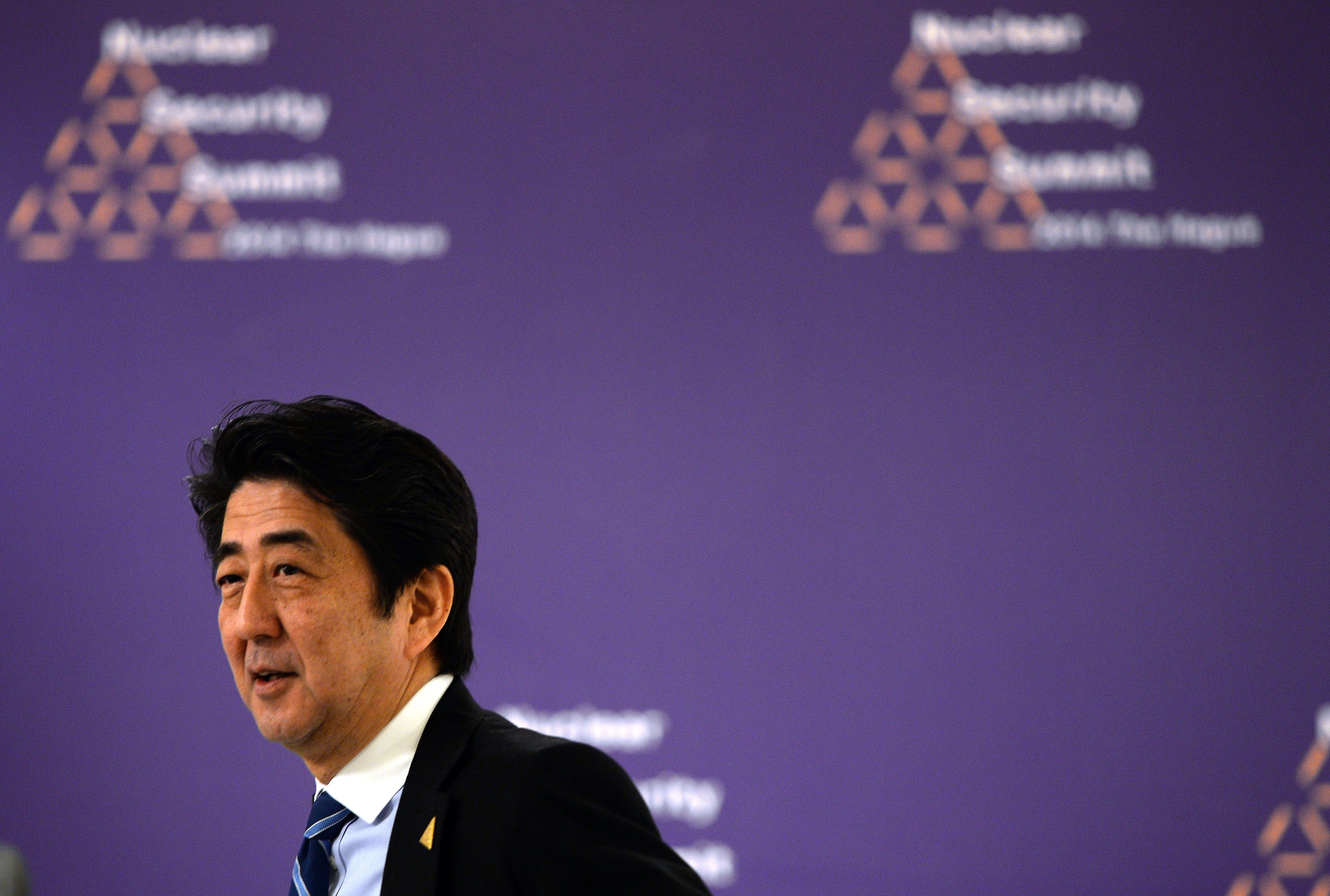 Japanese Prime Minister Shinzo Abe attends a bilateral meeting with the German chancellor on the sidelines of the Nuclear Security Summit (NSS) in The Hague on March 25, 2014. The world must construct a system to fight nuclear terror with the world's atomic watchdog playing a central role, a draft of the Nuclear Security Summit's final statement says.
