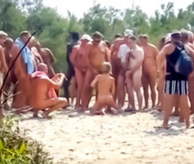 Group Of Guys Masturbates Onto Amateur Nudist Woman At Cap Dagde