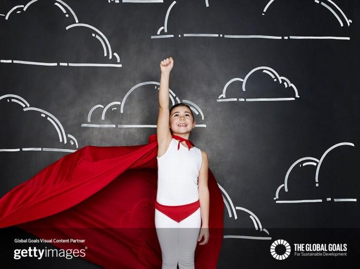 Portrait of girl dressed as a superhero
