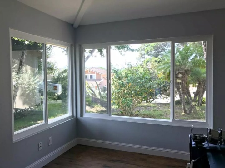 Before and after photos of our window replacement home improvement project. Not a DIY job for us but worth every penny of the cost. We went with vinyl windows instead of wood, and replaced the slider and screen instead of putting in french doors. Read the five biggest lessons we learned. #homeimprovement #diyproject #windows #interiordesign #investment #homedecor #beforeandafter