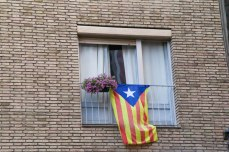 An Estelada flag hangs from a window in the Gothic Quarter in Barcelona.