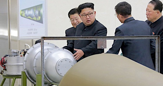 Kim Jong Un and H-Bomb fitting nose cone of ICBM, photo released September 2, 2017