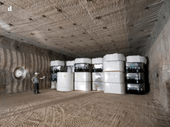 The Waste Isolation Pilot Plant (WIPP) is located in the massive salt of the Salado Formation. b. Contact Handled transuranic nuclear waste being transported to the WIPP site in New Mexico in TRUPac II containers. c. Remote Handled nuclear waste being transported to the WIPP site in a 72B cask. d. Over 10,000 nuclear waste drums and standard waste boxes filling 1 of 56 rooms to be filled at WIPP. Note the higher activity remote handled waste plunged into boreholes in the wall to the right (like SNF could be) and plugged with a 4-foot metal-wrapped cement plug. The Valentine's Day leak of 2014 occurred from a single drum in Panel 7 Room 7. Source: DOE CBFO