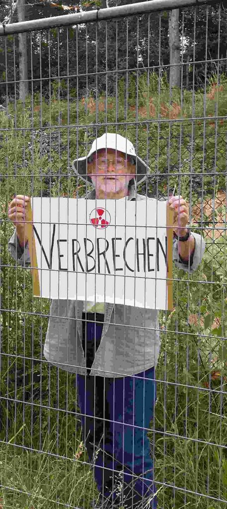 """""""Crime"""" reads the sign of the """"Treaty Enforcement Action"""" activist who entered the Buechel nuclear weapons base on July 10, 2019."""