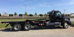 2017 Kenworth T880 Roll-Off Truck - side view