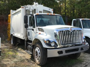 2010 International 7500 With 20yrd. E Z Pack Rear Loader