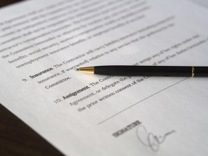 A signed document and a pen