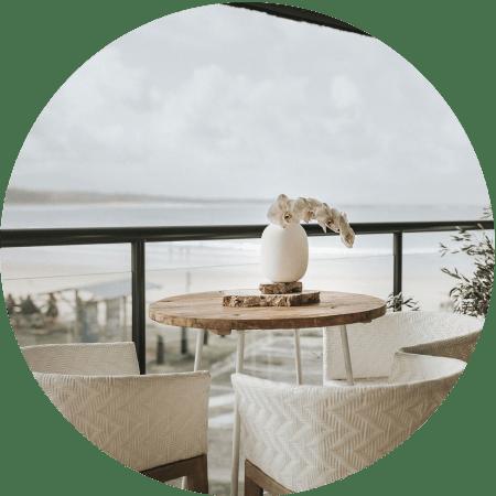 Chairs on balcony overlooking ocean