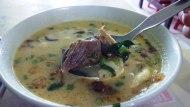 Soto Betawi H. Umar Idris. Isinya potongan daging tanpa lemak, daun bawang, bawang goreng, emping, disiram kuah santan soto. Nyamm :9