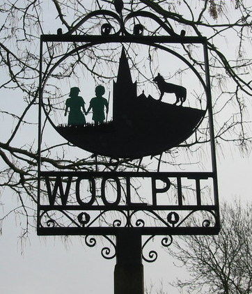 The village sign showing the children.  Photo by Rod Bacon