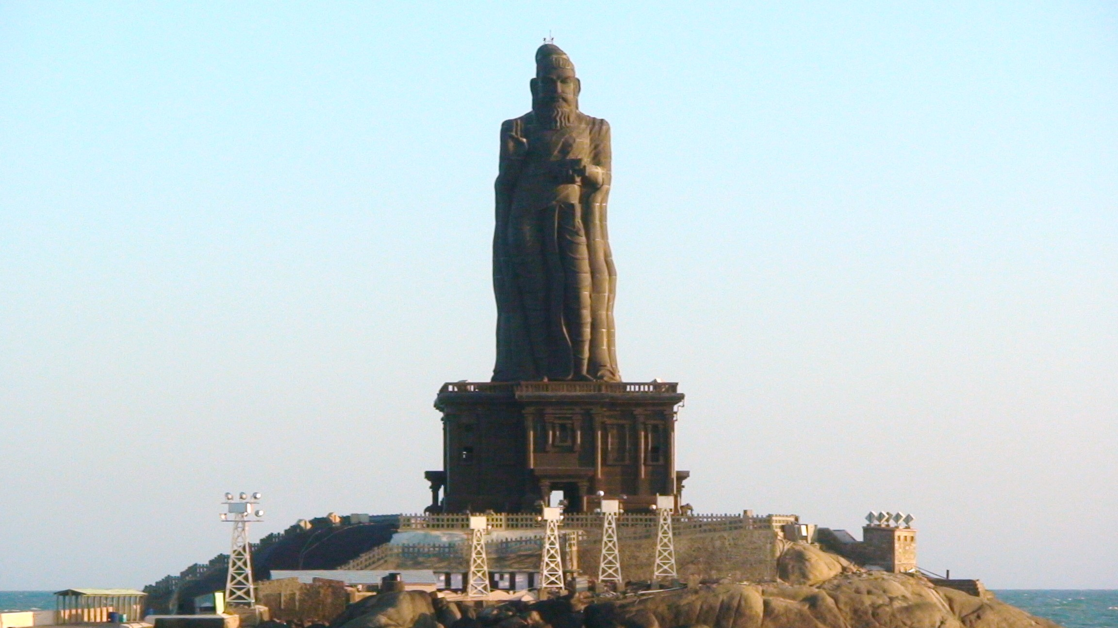 flirting the excellence of rain on translating tirukkural the colossal statue of tiruvalluvar built on a small islet at the meeting of the n ocean bay of bengal and arabian sea just offshore from the town