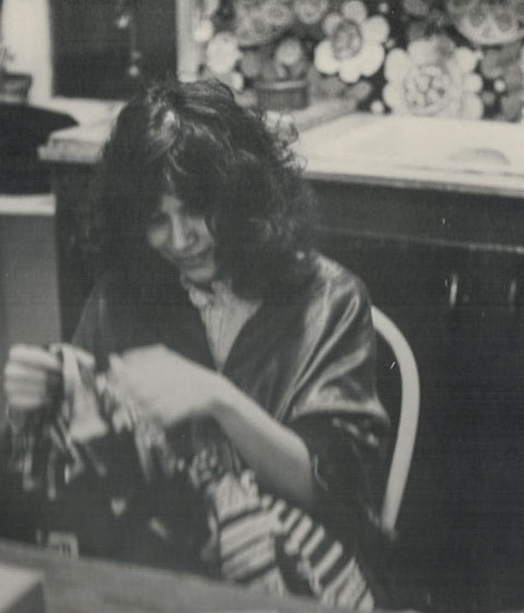 Karen Mulhallen sewing a kaftan 1974