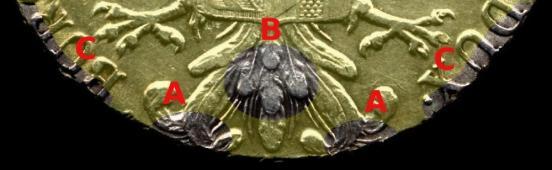 Figura 5: Caratteristiche salienti del rovescio del tallero coniato in Italia. La caratteristica C è relativa alla sola prima versione.