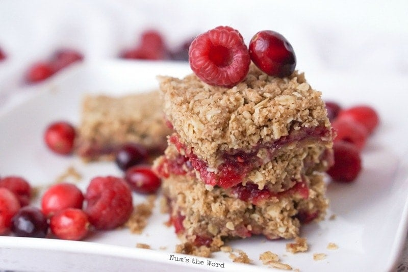 Leftover Cranberry Sauce Bars - down angle of cranberry bars stacked on top of each other.