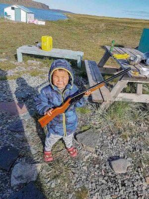 2409Cheryl Taptuna Cheryl Taptuna Kugluktuk Four-year-old Jaden Taptuna using a pellet gun, saying he's getting the biggest caribou.
