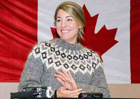 Federal Tourism Minister Mélanie Joly joins the applause over her announcement of almost $800,000 in CanNor funding going to projects in Chesterfield Inlet, Rankin Inlet and Whale Cove during a press conference in Rankin on Nov. 15, 2018. Darrell Greer/NNSL photo