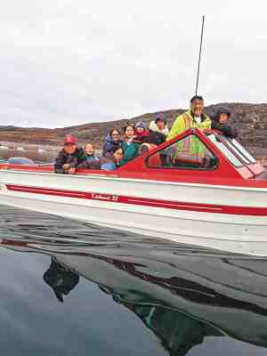 0402Tanya Qayaqsaaq Inutuinaq2<br /> Tanya Qayaqsaaq Inutuinaq<br /> Kugaaruk<br /> Qayaqsaaq's heading home from berry picking near Kugaaruk, NU.