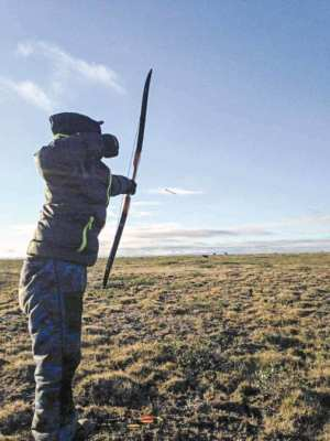 1102Peter Aqqaq_WINNER Peter Aqqaq Taloyoak Wayne Aiyout letting loose an arrow towards caribou. Photo taken near Taloyoak, August 2015.