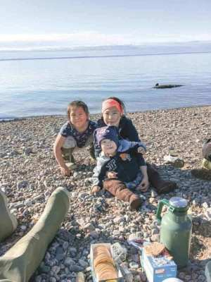 1802Helen Sikkuark Niptayok Helen Sikkuark Niptayok Kugaaruk This was summer of 2018 Janelle, Jeffrey and Lisa Niptayok. Behind them is their dad's catch in the water.