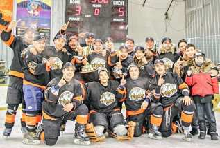 The B Division champion Team Tood isd, front row from left, Alfred Voisey, Elias Voisey, Chad Taipana and Deryk Voisey (waterboy), and, middle row from left, Robert Kabvitok, Hunter Nakoolak, Bobby Misheralak, Jason Todd, Nigel Kubluitok, Sandy Tattuinee (waterboy) and Mapsalaaq Komaksiutiksak (waterboy) and, back row from left, Silu Autut, Colton Graham, Ray Mercer Jr., Jeff Tulugak, Shawn Smith, Tony Dias, and Brady Tucktoo (stickboy) at the Terence Tootoo Memorial senior men's hockey championship in Rankin Inlet on March 10, 2019. Photo courtesy Brian Tattuinee