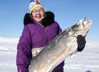 Debbie Baker proudly displays her awesome catch that measured-out at 43 1/16 inches during the Rankin Inlet Trout Derby in Rankin from May 18-21, 2018. photo courtesy of Pamela Pilakapsi