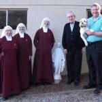 Cardinal Rigali, Bishop Stika and the Handmaids.