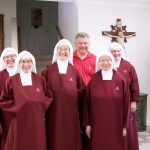 Bishop Stika with his Handmaids.