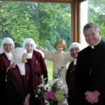 The Handmaids and Bishop Stika in the parlor at Heart of Mary Priory in Illinois.