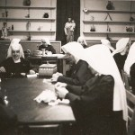 Sister Elizabeth, at the head of the table, during community recreation.