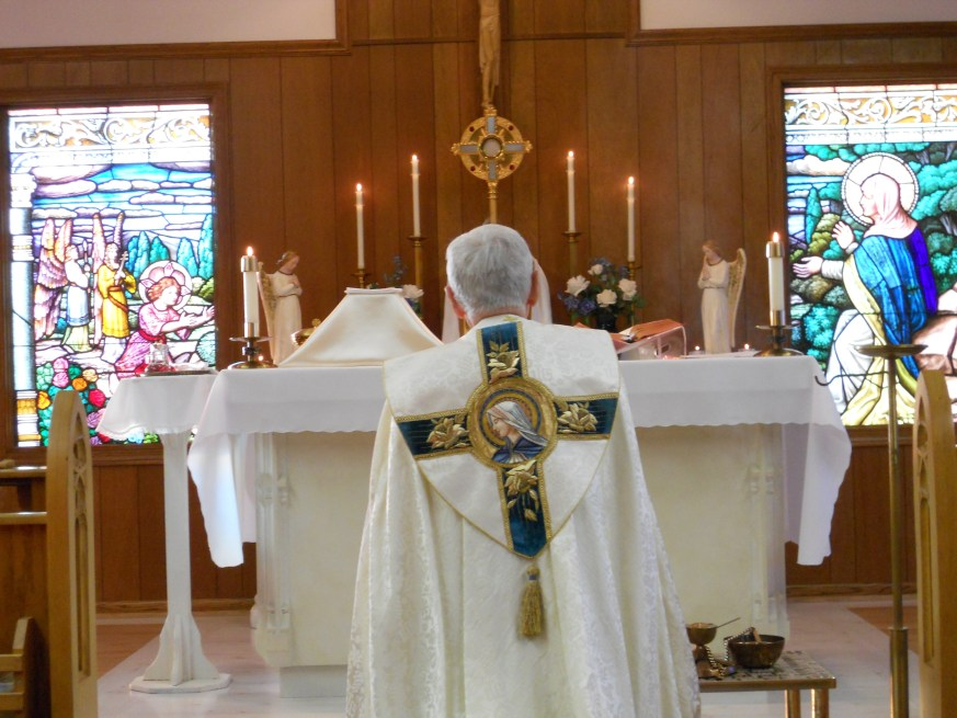 Father prepares to incense the Blessed Sacrament at the Heart of Mary Priory in Lake Villa, IL.