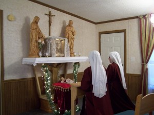 Sistersadore in the home chapel of one of our temporary residences during our initial settlement in Tennessee.