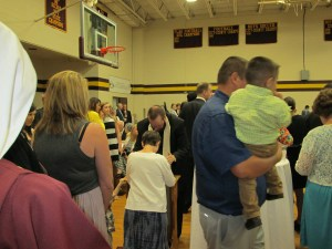 Crowds packed the gymnasium after the Ordination Mass to the receive the first blessings of the newly ordained.