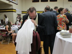 Father Ray Powell blessing a Handmaid.