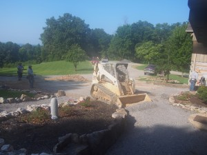 Leveling the ground in anticipation of the concrete.