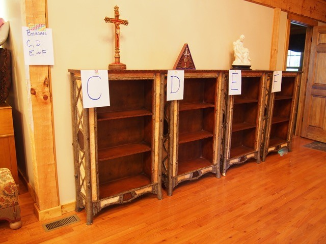Each of the 144 boxes was marked with a number or letter telling the men where it should be placed. These were the only four shelves (came with the house) ready to take books.