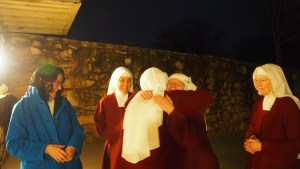 Celebrations and first Christmas greetings all around outside Chapel after Midnight Mass.
