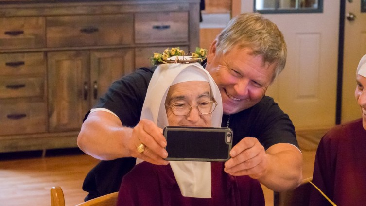 """Bishop teaches Sister Rose Anne all about """"selfies"""". She was a great sport about it."""
