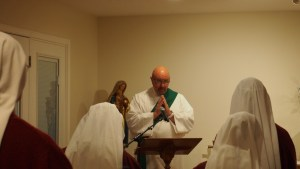 Deacon Scott gives a short homily on the day's readings.