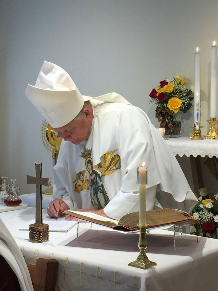 Bishop Stika signs the vow formula