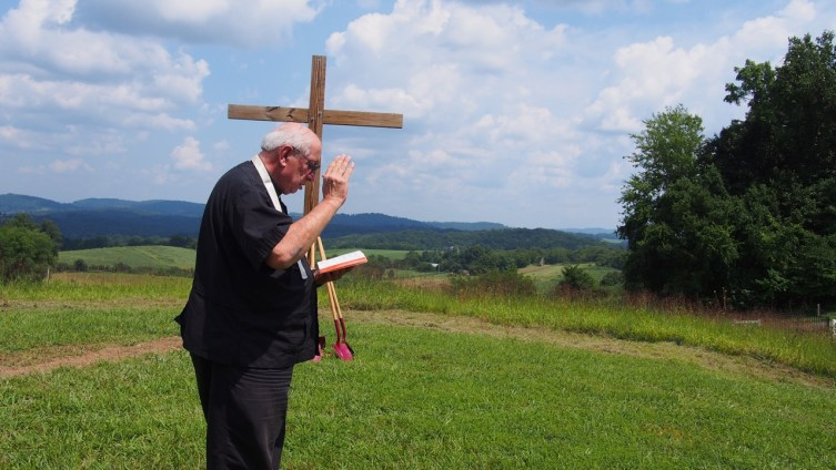 Father Patrick Resen blesses the site