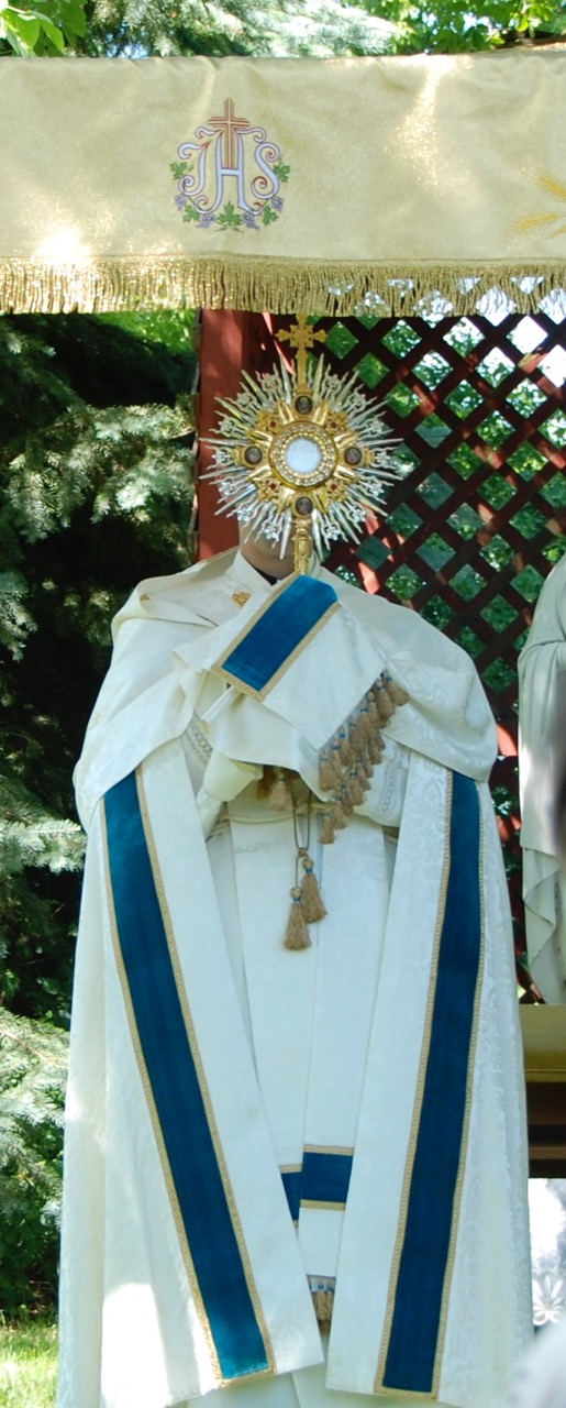 Benediction under the canopy at several altars on the grounds of Heart of Mary Priory.