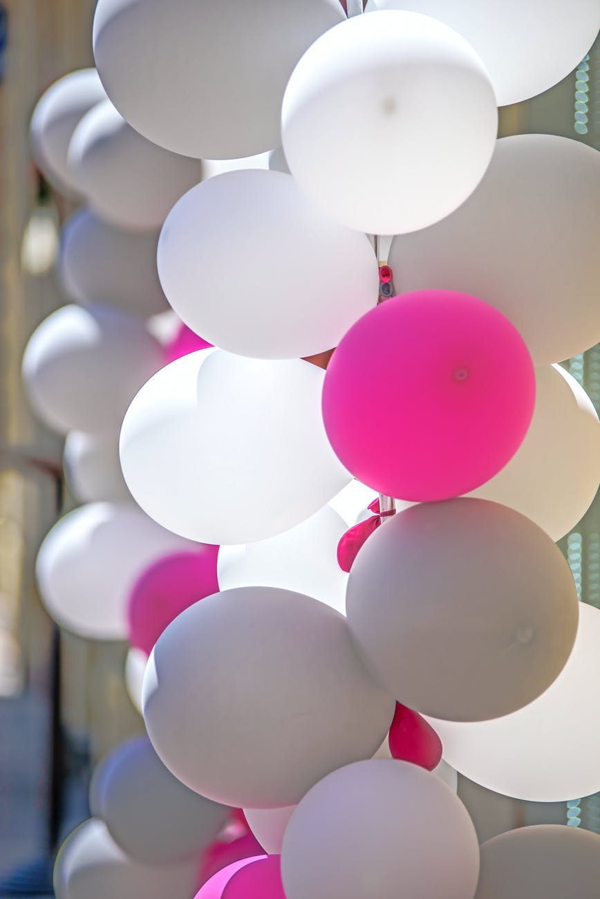 white and pink balloons decor