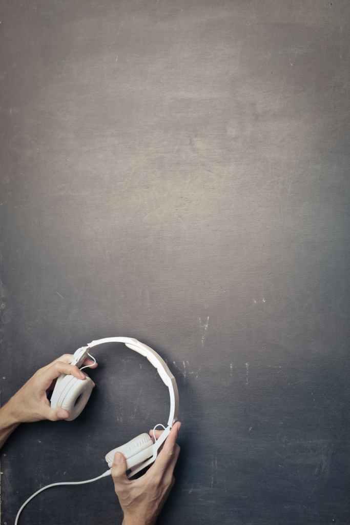 crop man with wired headphones in studio