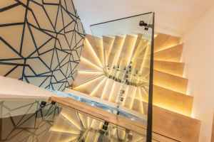 illuminated stairway with glass railing