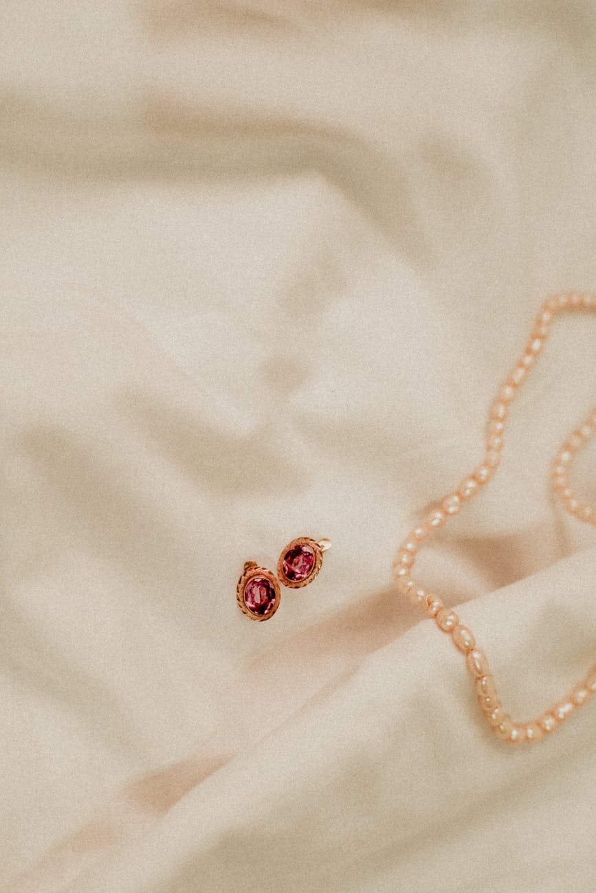 pearl necklace and pair of earrings